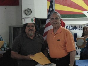 LUPE member and new citizen Fidel Rodriguez receives certificate of recognition from Congressman Rubén Hinojosa