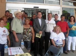 LUPE members and organizers pose with District Director Solomon Torres