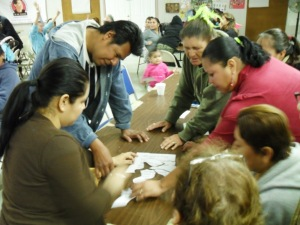 Residents from different colonias work together to assemble a quote representing LUPE's philosophy and ideals