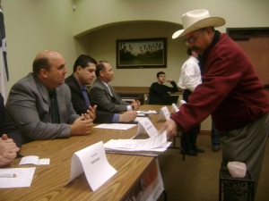Leader Don Francisco presents a resolution to the Valley delegation of the Texas Legislature