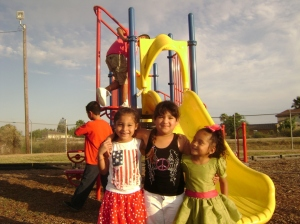 Kids in front of Teresa Barrera Park